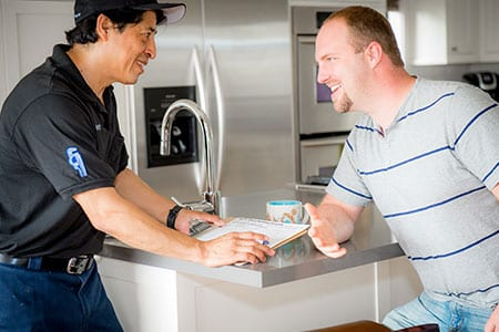 Plumber Working with a Client