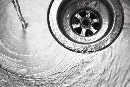 sink-with-water-running-down-drain